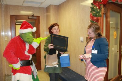 grinch wagging finger with certificate